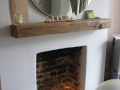 A mantelpiece made from an old railway sleeper