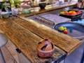 A kitchen island counter made from recovered wood