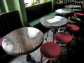 Tables with recovered wood surfaces at a Brighton pub